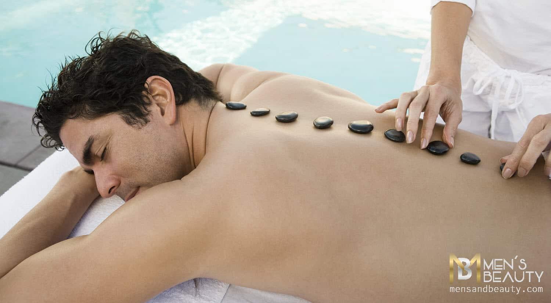 tipos de masajes para hombre piedras calientes